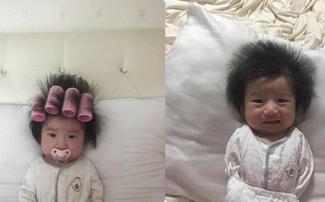 Vừa cuốn lô vừa ngậm ti giả, em bé mặt méo xệch nhận thành quả tóc dựng ngược chẳng giống ai