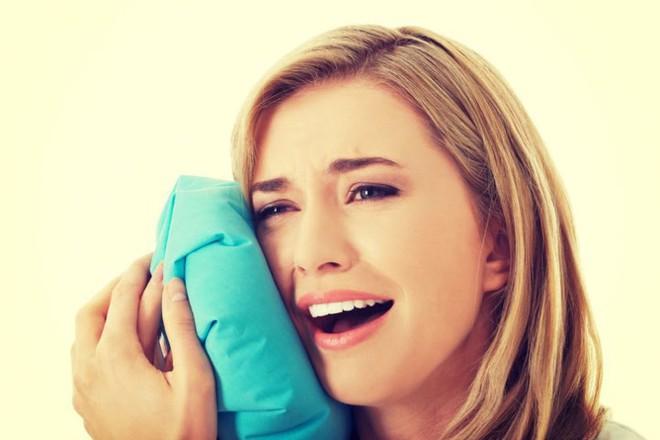 11 cách giúp bạn dịu cơn đau do mọc răng khôn - Ảnh 3.