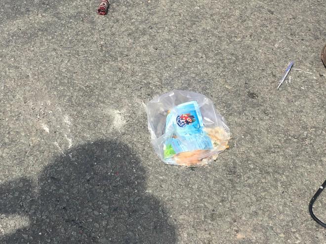 Đi mua đồ ăn sáng, người phụ nữ bị xe container ôm cua cán chết thương tâm - Ảnh 2.