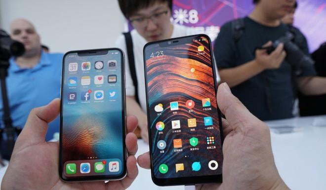 Ở Trung Quốc, người dùng iPhone học vị thấp và nghèo khó hơn nhóm dùng Huawei, Xiaomi  - Ảnh 1.