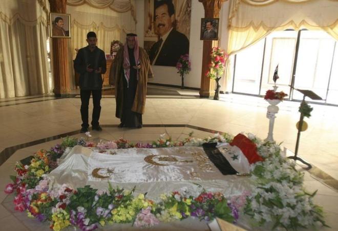 Bí ẩn tung tích thi hài Saddam Hussein - Ảnh 1.