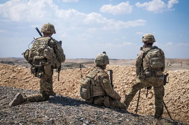 Rút lính Mỹ khỏi Syria: Buông bỏ để tự cứu chính mình, ông Trump tránh dẫm vào chân một đồng minh lớn - Ảnh 2.