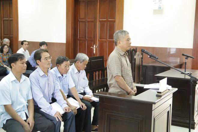 Cựu Phó thống đốc NHNN Đặng Thanh Bình bị giữ nguyên cáo buộc gây thiệt hại 15.000 tỷ đồng - Ảnh 1.