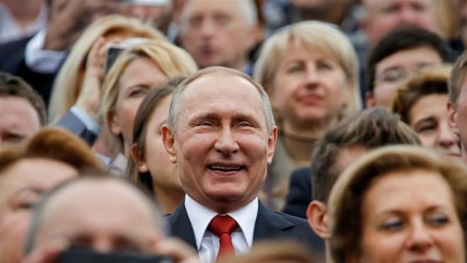 Bất chấp hình ảnh ông Putin bị bôi xấu, công chúng thế giới tin Nga quan trọng hơn Mỹ - Ảnh 1.