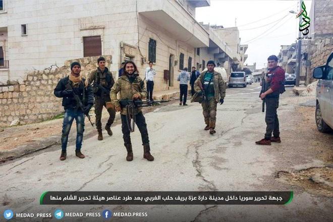 Cuộc chiến một mất một còn ở Idlib, Syria: Khủng bố tự tàn sát nhau đẫm máu - Ảnh 7.