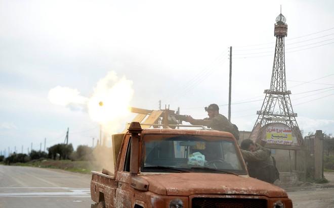 24h qua ảnh: Chiến binh quân nổi dậy Syria xả súng máy vào quân chính phủ - Ảnh 4.