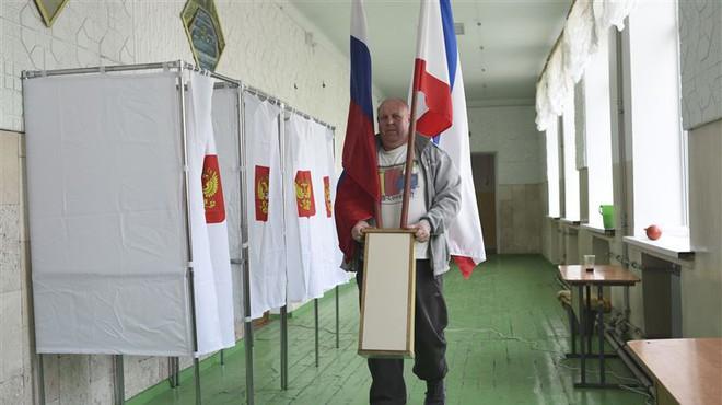 [CẬP NHẬT] Tổng tuyển cử Nga 2018: Ukraine tăng cường vệ binh ngăn công dân Nga đi bỏ phiếu - Ảnh 3.