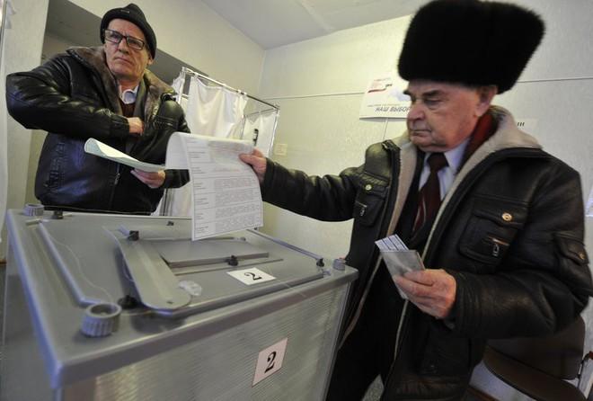 [CẬP NHẬT] Tổng tuyển cử Nga 2018: Ukraine tăng cường vệ binh ngăn công dân Nga đi bỏ phiếu - Ảnh 1.