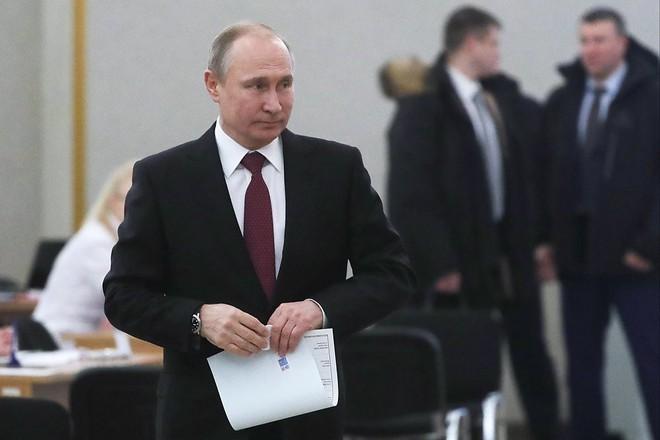 Bầu cử tổng thống Nga 2018: Ông Putin đi bỏ phiếu tại cùng địa điểm tổng tuyển cử 2012 - Ảnh 2.