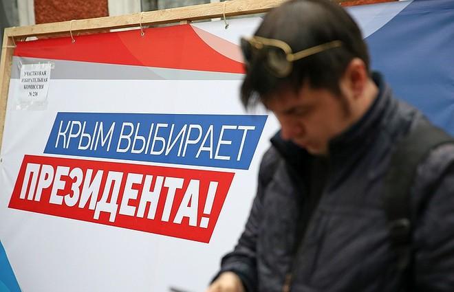 Bầu cử tổng thống Nga 2018: Ông Putin đi bỏ phiếu tại cùng địa điểm tổng tuyển cử 2012 - Ảnh 1.