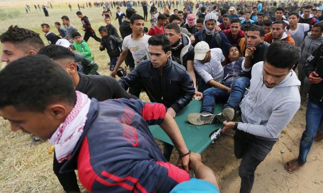 Dải Gaza: Xe tăng Israel bắn chết người Palestine, lính bắn tỉa IDF không ngừng nã đạn - Ảnh 4.