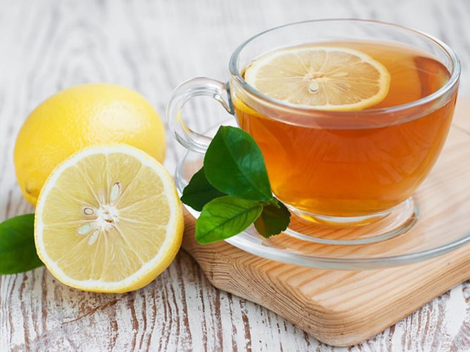 Không phải ai cũng biết hết công dụng của nước chanh mật ong - Ảnh 1.