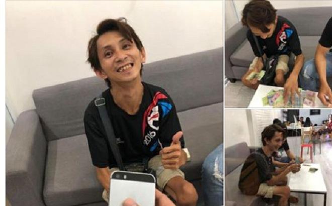 Chàng trai đi xe lăn bán vé số gom tiền nửa năm mua iPhone 5 và cái kết khiến dân mạng cảm động