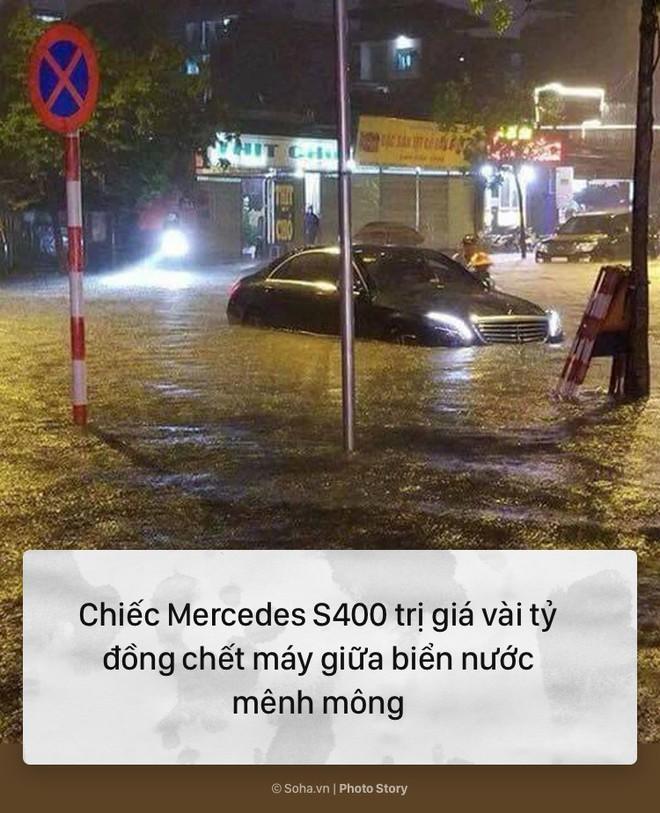 [PHOTO STORY] 10 hình ảnh ấn tượng nhất tại Hà Nội trong cơn mưa lớn tối 12/5 - Ảnh 1.