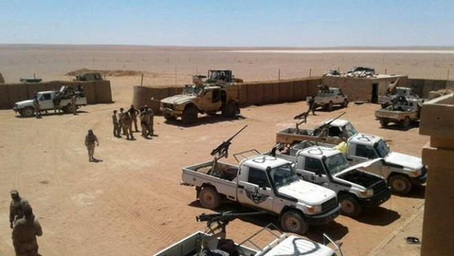 Không kích quân đội Syria - Trò chơi chết chóc mới của Mỹ? - Ảnh 1.