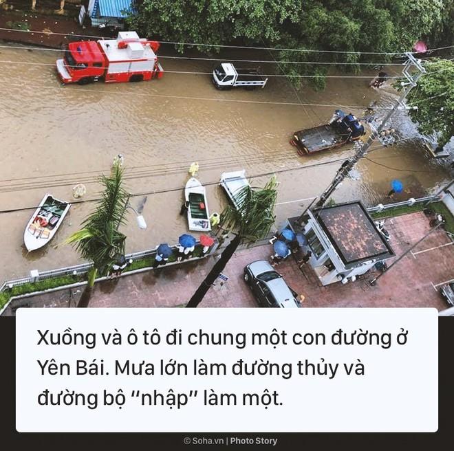 [Photo Story] Cảnh phố như sông ở nhiều tỉnh thành sau cơn bão số 3 - Ảnh 5.