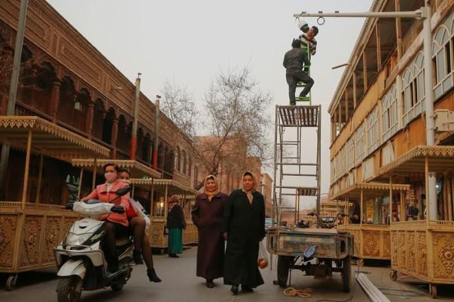 LHQ báo cáo TQ lập trại bí mật nhốt hàng triệu người ở Tân Cương, tờ Hoàn Cầu nổi đóa - Ảnh 1.