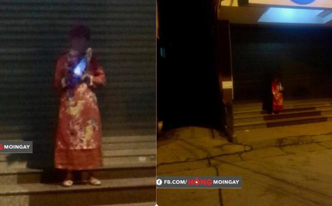 12h đêm, một người mặc áo quan đứng trước ngân hàng khiến ai đi qua cũng giật mình