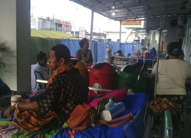 Ảnh: Indonesia tan hoang sau thảm họa động đất, sóng thần - Ảnh 10.
