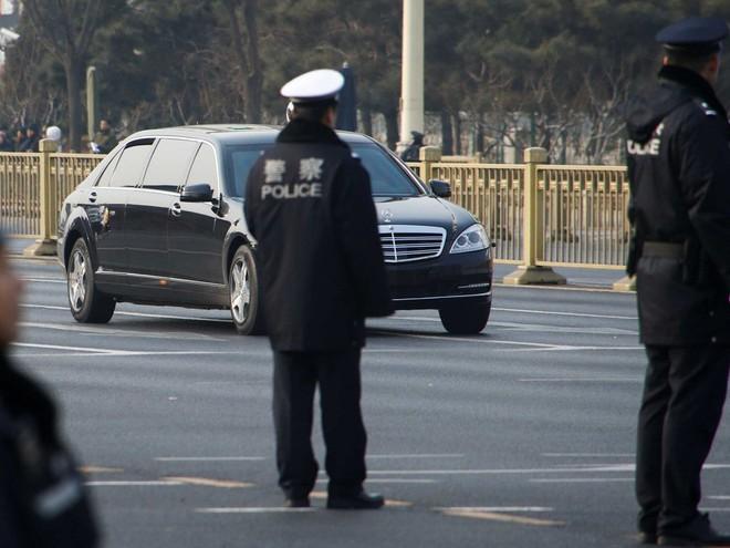 Tại sao nhà lãnh đạo Triều Tiên Kim Jong-un mặc áo khoác đen, đội mũ đen khi đến Bắc Kinh? - Ảnh 5.