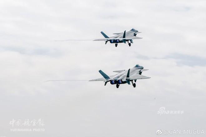 Trung Quốc tiếp tục khoe tiêm kích J-20 giữa lúc căng thẳng với Mỹ - Ảnh 9.