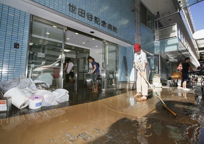 Hàng chục nghìn binh sĩ, trực thăng Nhật Bản đương đầu với hậu quả thảm khốc của bão quái vật Hagibis - Ảnh 10.