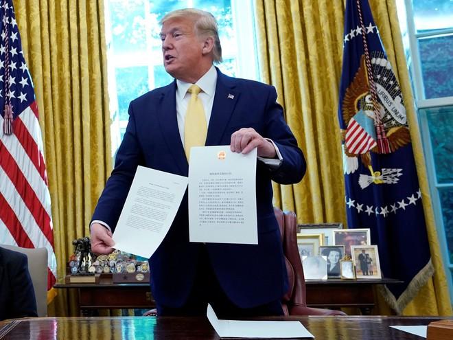 Thỏa thuận Mỹ-Trung giai đoạn 1: Thực chất là bong bóng căng phồng chờ nổ, đưa đến cuộc chiến khốc liệt hơn? - Ảnh 1.