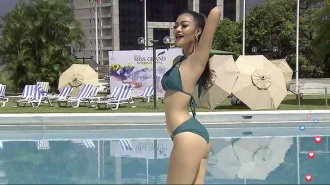 Kiều Loan uyển chuyển, phô đường cong thể hình với bikini tại Miss Grand - Ảnh 4.