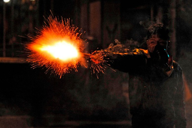 7 ngày qua ảnh: Cầu vồng xuất hiện trong cuộc đụng độ giữa biểu tình ở Chile - Ảnh 11.