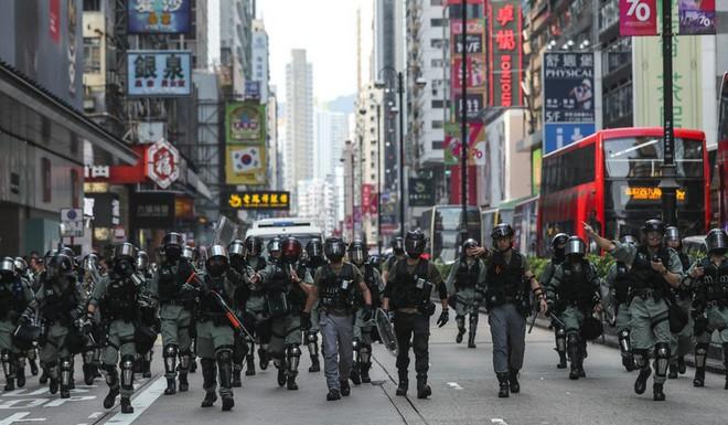 Đối phó biểu tình, Hong Kong thuê thêm 1.000 cảnh sát - Ảnh 2.