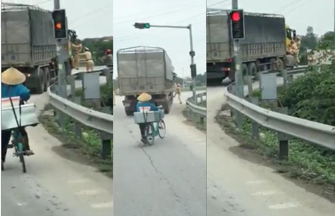 Bị yêu cầu dừng xe, tài xế xe tải tông thẳng vào CSGT rồi bỏ chạy - Ảnh 2.