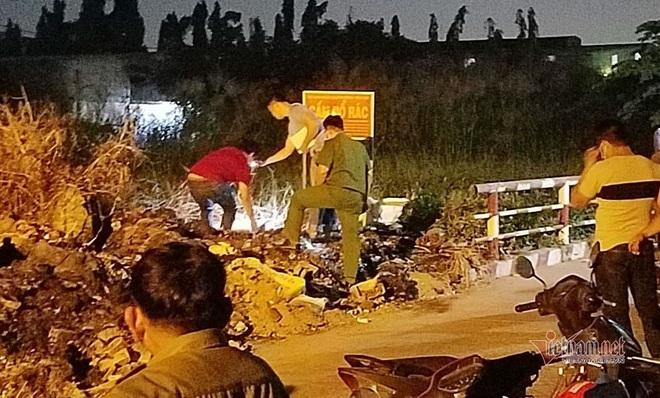 Chen chúc xem xác chó nằm trong hộp đá hoa cương ở bãi rác Sài Gòn - Ảnh 2.