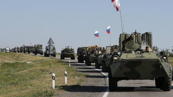 Đoàn xe tuần tra của quân cảnh Nga bị Mỹ chặn lại bằng vũ lực - Ảnh 14.