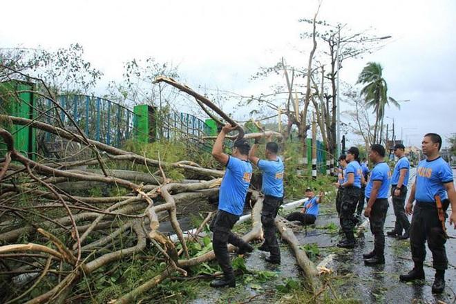 Hình ảnh mưa bão càn quét Philippines, nhiều môn thi SEA Games bị huỷ - Ảnh 7.