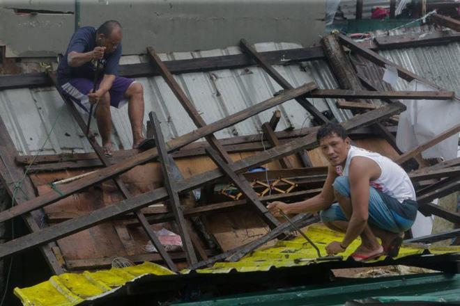 Hình ảnh mưa bão càn quét Philippines, nhiều môn thi SEA Games bị huỷ - Ảnh 8.