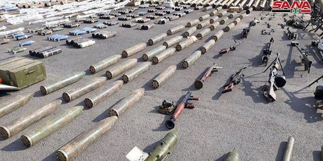 """Quân đội Syria thu hoạch vũ khí của """"quân thánh chiến"""" tại ngoại ô Damascus - Ảnh 3."""