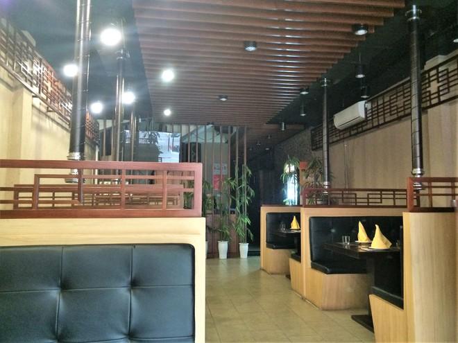 Bí ẩn nhà hàng do người Triều Tiên phục vụ ở Hà Nội - Ảnh 1.