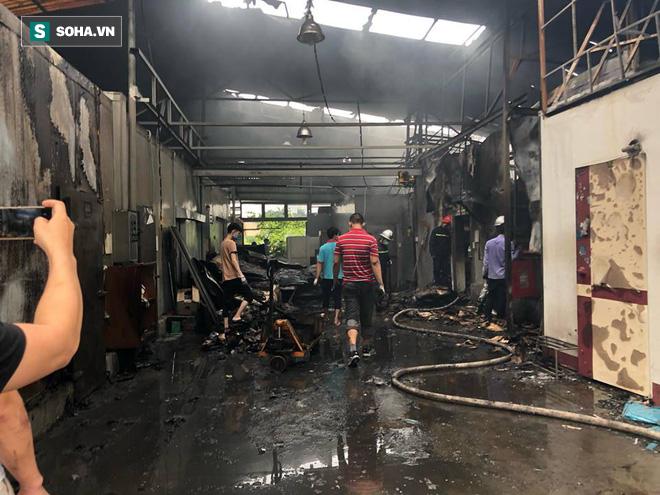 Hiện trường vụ cháy 4 xưởng trong đêm khiến 8 người chết và mất tích ở Hà Nội - Ảnh 6.