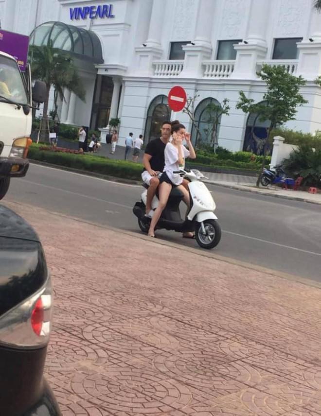 Hồ Ngọc Hà chở Kim Lý bằng xe máy mà không đội mũ bảo hiểm gây tranh cãi - Ảnh 2.