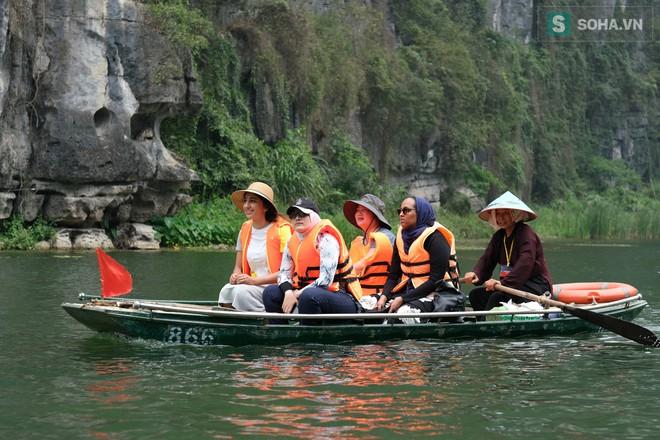 Lễ hội rước rồng độc đáo trên sông nước ở Tràng An - Ninh Bình - Ảnh 14.