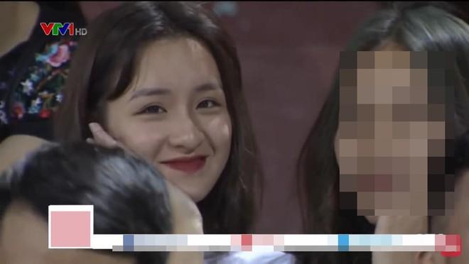 Xuất hiện vài giây trên bản tin truyền hình, cô gái Hà Nội bỗng được dân mạng truy lùng - Ảnh 1.