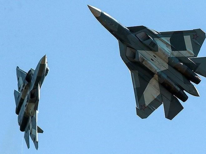 Tối hậu thư Gấu Nga gửi tới Mỹ và NATO: Nếu muốn gây chiến hãy nhớ tới 76 máy bay Su-57! - Ảnh 1.