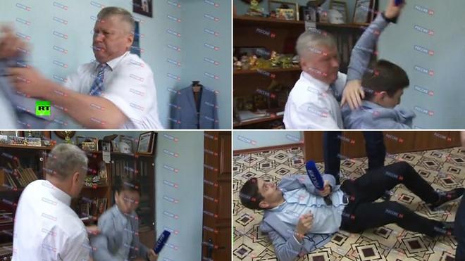 Bị hỏi khó, quan chức Nga quật ngã phóng viên trên sóng truyền hình - Ảnh 1.