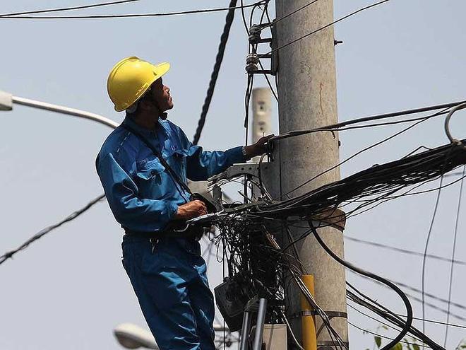 Người dùng phải trả cao hơn giá điện bình quân - Ảnh 1.