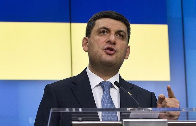 Ukraine coi hộ chiếu Nga cấp cho dân Donbass vô giá trị - Ảnh 1.