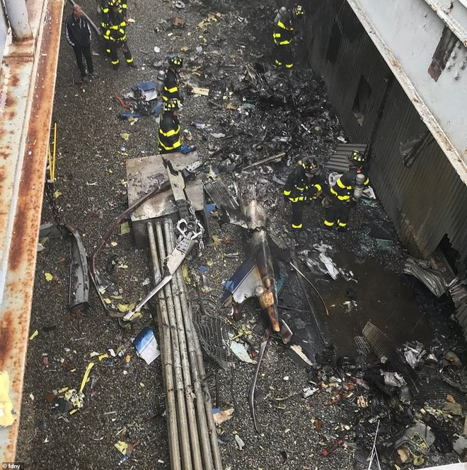 Hiện trường vụ trực thăng lao vào tòa nhà 54 tầng ở New York - Ảnh 6.