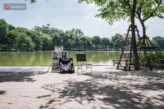 Chùm ảnh: Phố đi bộ hồ Gươm vắng tanh trong ngày nắng nóng kinh hoàng ở Hà Nội - Ảnh 8.