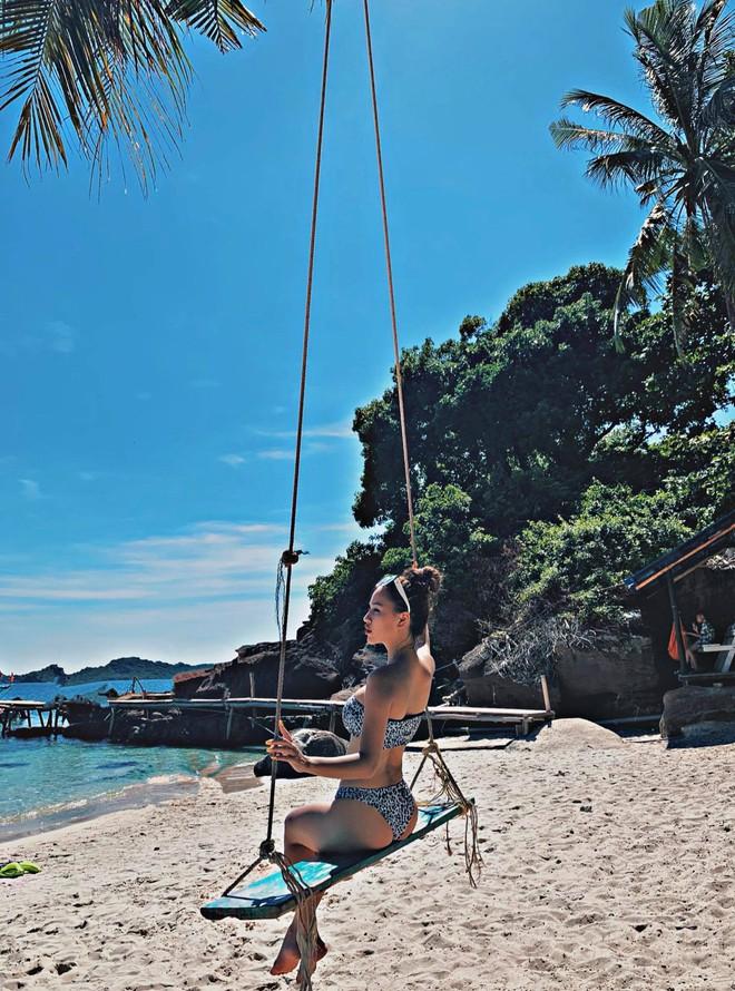 DJ Tít hậu ly hôn: Sống vui vẻ, liên tục tung ảnh bikini khoe thân hình săn chắc, gợi cảm  - Ảnh 1.