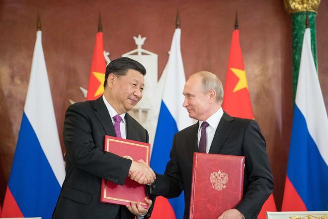Ngồi bên ông Tập Cận Bình, TT Putin 7 lần vỗ mặt Mỹ không nể nang: Không hổ danh là người bạn tốt nhất! - Ảnh 2.