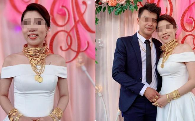 Hình ảnh cô dâu đeo vàng nặng trĩu cổ và kín 2 bàn tay trong ngày cưới khiến dân mạng trầm trồ